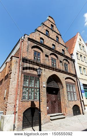 KOLOBRZEG POLAND - JUNE 23 2016: Made of brick Townhouse of Merchants was built early of the 15th century and after war damage rebuilt in 1963 it is a part of European Route of Brick Gothic