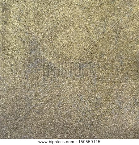 decorative plaster surface with the effect of gold with nacre
