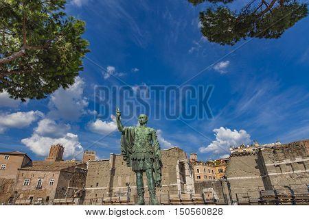 Emperor Julius Caesar Statue In Front Of Ancient Trajan's Market In Rome