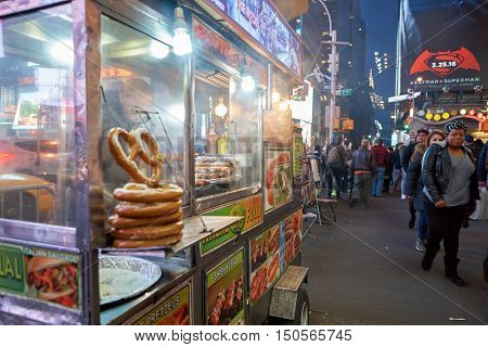 NEW YORK - CIRCA MARCH, 2016: street food cart in New York City. Street food is ready-to-eat food or drink sold by a hawker, or vendor, in a street or other public place, such as at a market or fair.