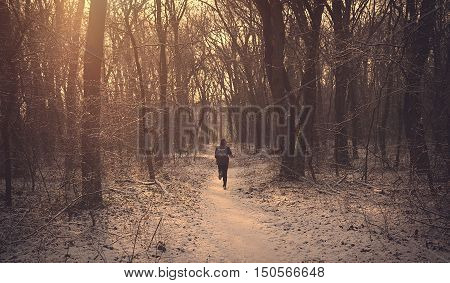 Man Running In The Winter Forest