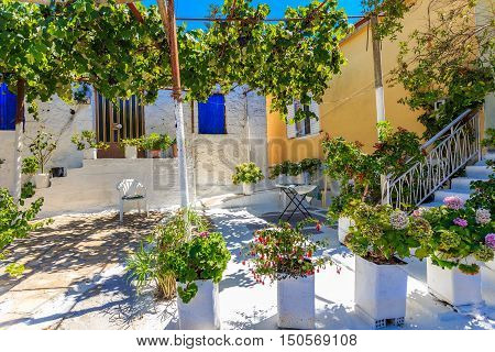 midday at traditional greek village house and patio