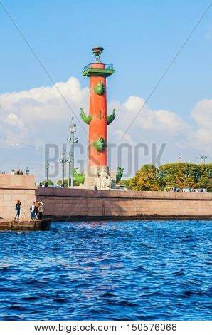 ST PETERSBURG RUSSIA -OCTOBER 3 2016. St Petersburg architecture view. Neva river and St Petersburg landmark of Vasilievsky island spit - rostral column in St Petersburg Russia in autumn nice weather
