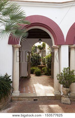 Entrance arch of a typical spanish andalusian patio in Roc de Sant Gaieta Tarragona Catalunya Spain. poster
