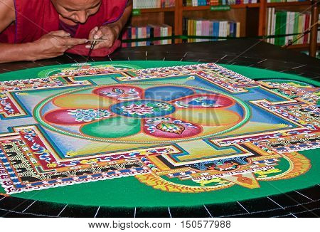 TEPOZTLAN / MEXICO - MAY 31 2016: Tibetan mandala made with coloured sand in a Tepoztlan visit of the Drepung Loseling monastery monks