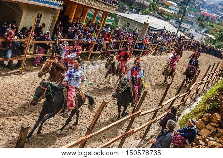 Todos Santos Cuchumatan, Guatemala - November 1 2011: Drunken locals race up & down dirt track on horseback in unique celebration of All Saints' Day in highland town of Todos Santos Cuchumatan, Huehuetenango