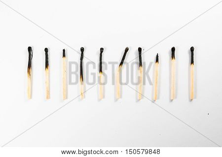 Match Stick Macro Detail Fire Symbol Safety White Isolated Background Charred Used Burned Burnt Black Wood Row Single Campfire