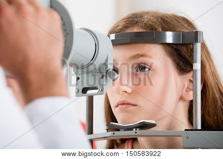 Close-up Of An Optometrist Doing Vision Testing Of Girl