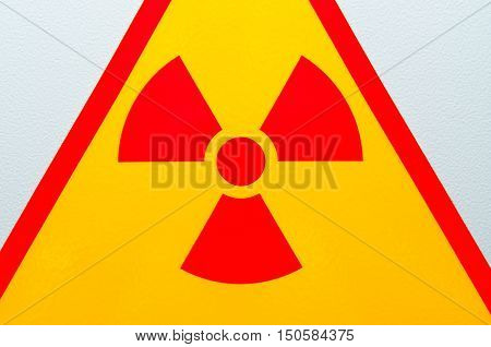 Bright warning sign of radiation safety talking about the dangers