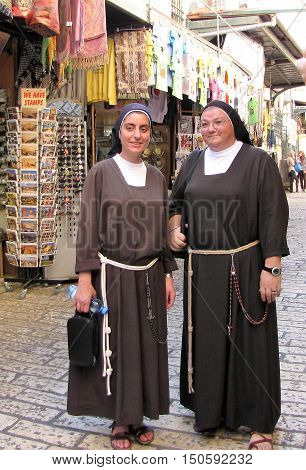 JERUSALEM, ISRAEL - NOVEMBER, 2014 : Two nuns gladly poise for tourist along the Via Dolorosa in the Old City of Jerusalem