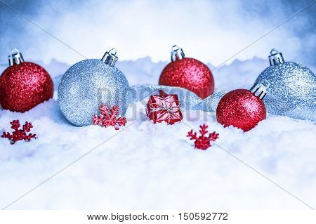 christmas ornaments in snow on glitter background with copy space. studio shot