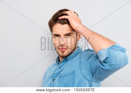Portrait Of Handsome Young Guy Combing His Hair With Fingers