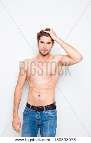 Young Muscular Man In Jeans Combing Hair With Fingers