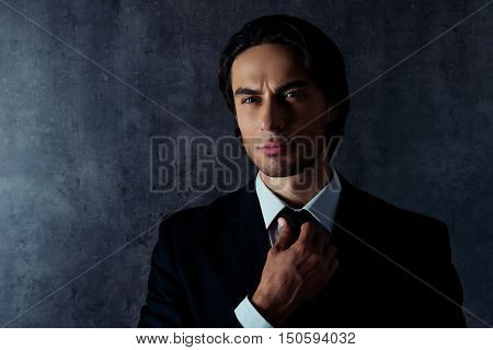 Confident  Brutal Man  Correcting His Black  Tie