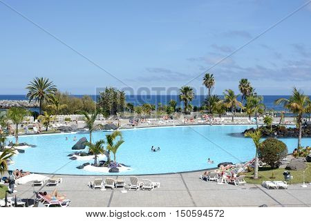 SANTA CRUZ, TENERIFE - APRIL 17, 2016: Outdoor swimming pool, Parque Maritimo Cesar Manrique in Santa Cruz de Tenerife, Spain.