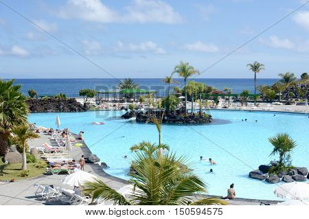 SANTA CRUZ, TENERIFE - APRIL 17, 2016: Outdoor swimming pool, Parque Maritimo Cesar Manrique in Santa Cruz de Tenerife, Spain.
