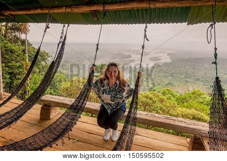 European Blonde Woman Noticing Part Of The Amazonian Basin From An Observation High Point Ecuador South America