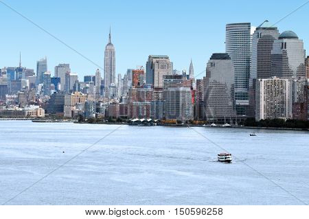 Manhattan skyline as view from the Hudson river with the Empire State Building in the background Manhattan New York.