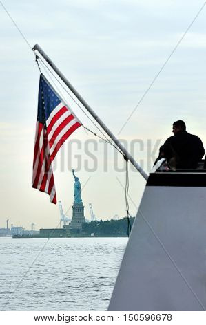 American people looks at the Statue of liberty from a boat Manhattan New York USA.