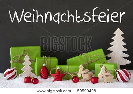 German Text Weihnachtsfeier Means Christmas Party. Green Gifts Or Presents With Christmas Decoration Like Tree, Moose Or Red Christmas Tree Ball. Black Cement Wall As Background With Snow.