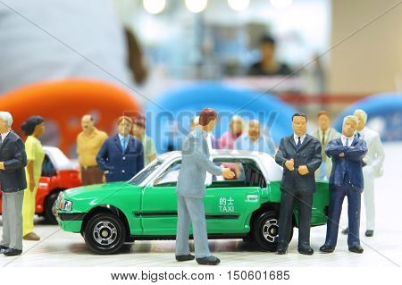 Model Taxi And Small Figures