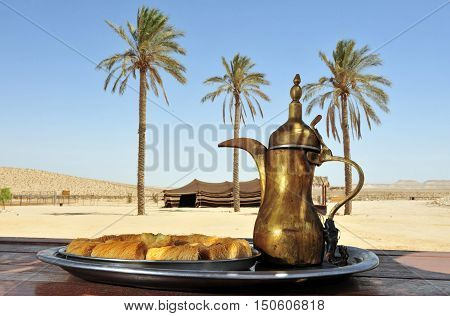 Bedouin desert hospitality. Arab food tray background