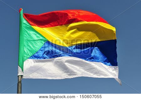 A colorful Druze Flag Flying in the Wind.