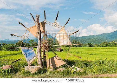 Turbine baler in rice farm Thailand countryside