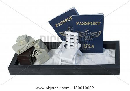 Suitcases and Aidrondack Beach Chair in the Sand with Passports to show a beach holiday - path included