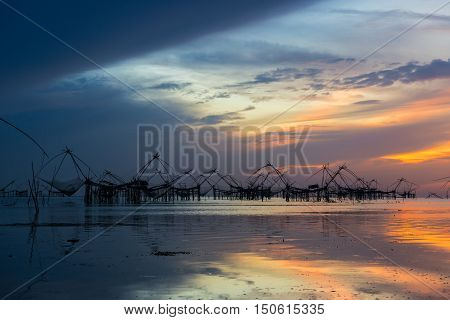 Thai style fishing trap in sunset, Thailand
