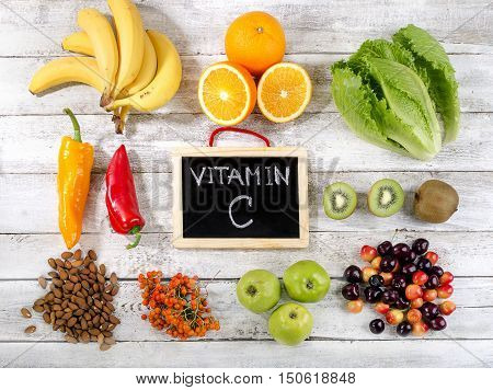 Foods High In Vitamin C On  Wooden Background.
