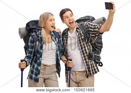 Cheerful young hikers taking a selfie isolated on white background