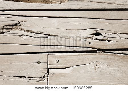 Old rough wood board with nails. background texture