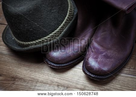 American West rodeo cowboy dirty and used brown boots and hat