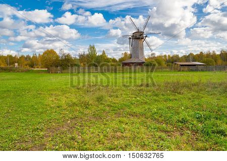 an old wooden windmill in autumn season