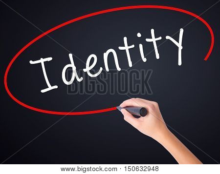 Woman Hand Writing Identity With A Marker Over Transparent Board