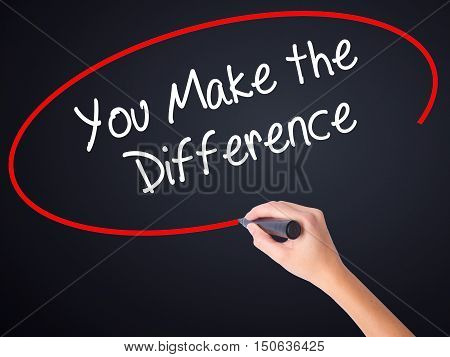 Woman Hand Writing You Make The Difference With A Marker Over Transparent Board