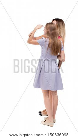 Back view of two young girl. Rear view people collection.  backside view of person. Rear view. Isolated over white background. Two girls embracing.