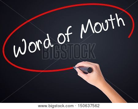 Woman Hand Writing Word Of Mouth  With A Marker Over Transparent Board
