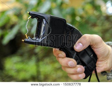 Man with a lightning high voltage stun gun