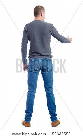 Back side view of man  in shirt handshake.  Rear view people collection.  backside view of person.  Isolated over white background. A guy in a gray sweater holds out his hand in greeting.