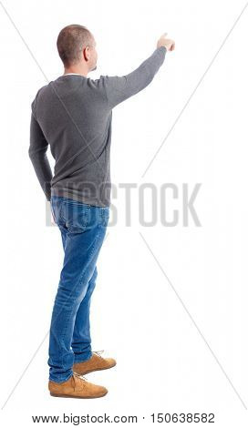 Back view of  pointing young men in  shirt and jeans. Young guy  gesture. Rear view people collection.  backside view of person.  Isolated over white background. A guy in a gray sweater shows finger