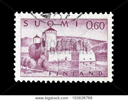 FINLAND - CIRCA 1963 : Cancelled postage stamp printed by Finland, that shows Olavinlinna fortress.