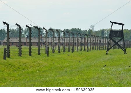 OSWIECIM POLAND - MAY 12 2016: Block of concentration camp Auschwitz Birkenau II behind the fence of barbed wire in Brzezinka Poland.