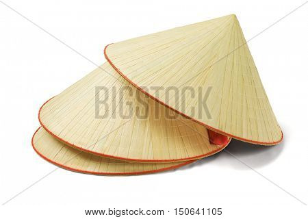 Stack of Oriental Straw Hats on White Background
