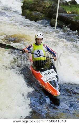 FRONGOCH WALES UNITED KINGDOM OCTOBER 5 2016: White water canoeist competing in the Canoe Wales National Slalom at the National White Water Centre on the River Tryweryn Frongoch North Wales