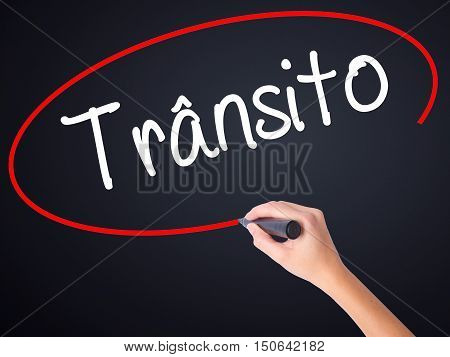 Woman Hand Writing Transito (traffic In Portuguese) With A Marker Over Transparent Board