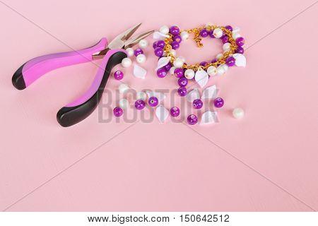 Pliers, bracelet, plastic beads. How to make a bracelet.
