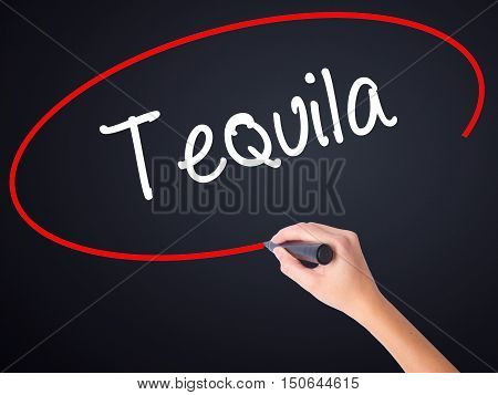 Woman Hand Writing Tequila With A Marker Over Transparent Board
