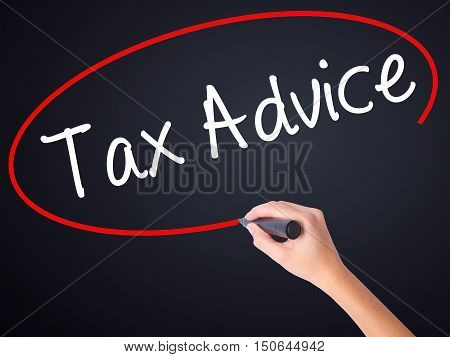 Woman Hand Writing Tax Advice With A Marker Over Transparent Board